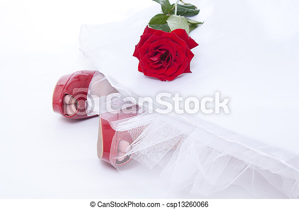 Bride feet in red shoes with rose - csp13260066