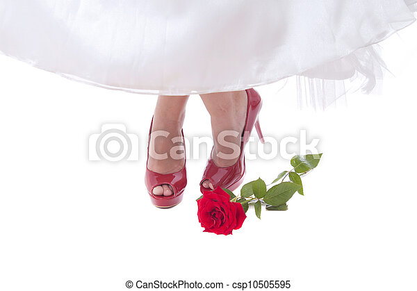 Bride feet in red shoes with rose - csp10505595