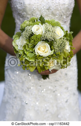 bride holding a wedding bouquet - csp11163442