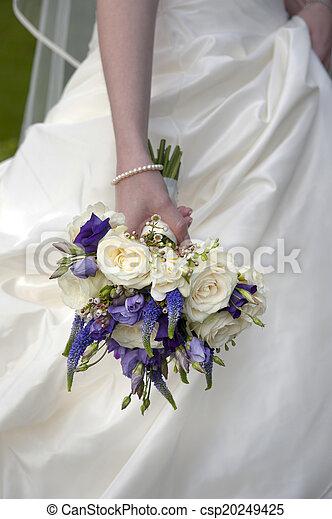Bride holding a wedding bouquet bride holding a purple and white bride holding a wedding bouquet csp20249425 mightylinksfo