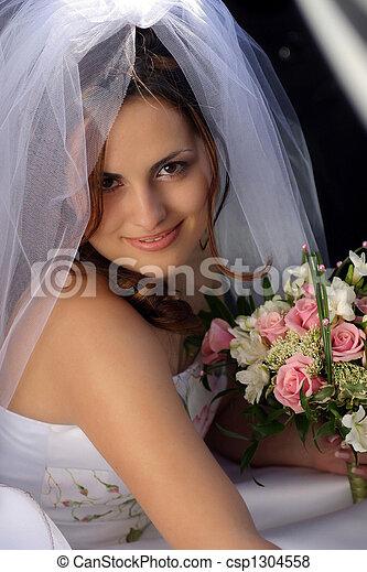 Bride in white wedding dress - csp1304558