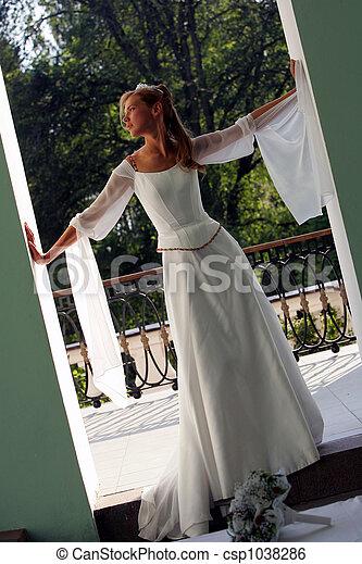 Bride in white wedding dress - csp1038286
