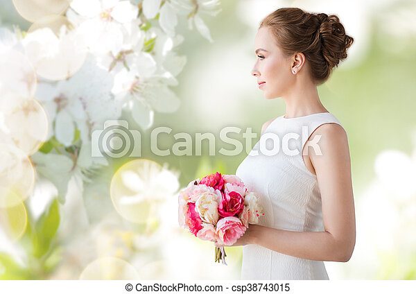 bride or woman in white dress with flower bunch - csp38743015
