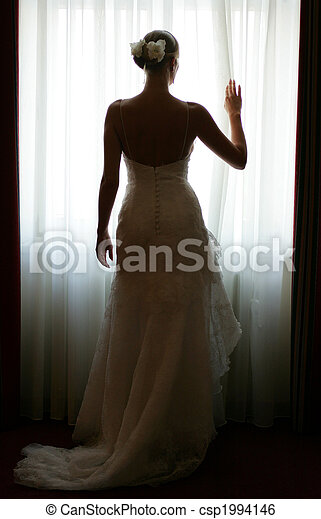 Bride silhouetted by window - csp1994146