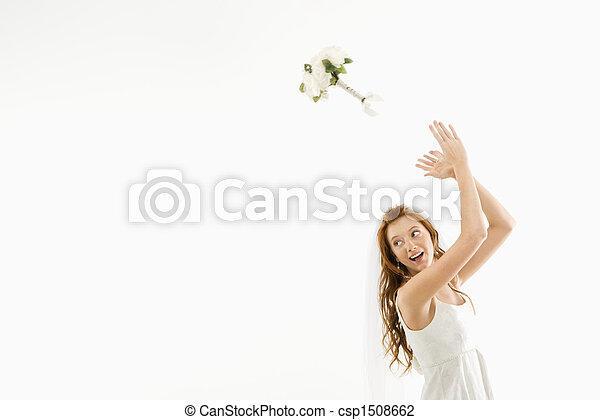 Bride tossing bouquet. - csp1508662