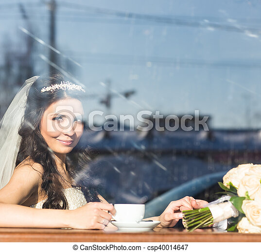 bride with a cup of coffee - csp40014647