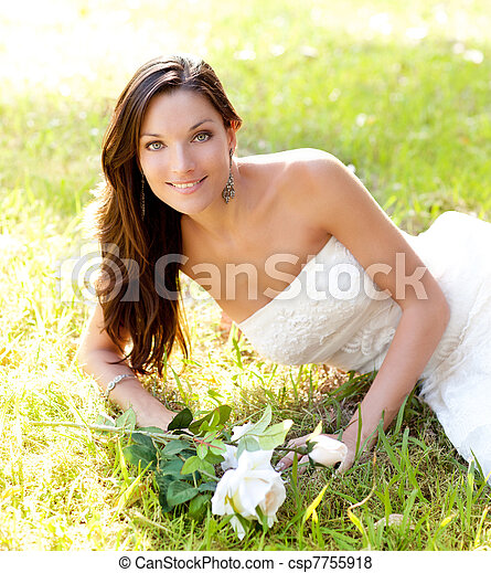 bride woman lying in park grass - csp7755918
