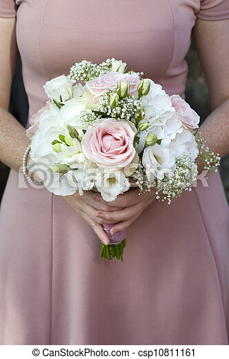 bridesmaid holding a wedding bouquet of pink flowers - csp10811161