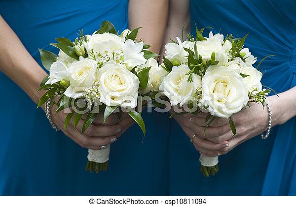 bridesmaids holding wedding bouquets - csp10811094