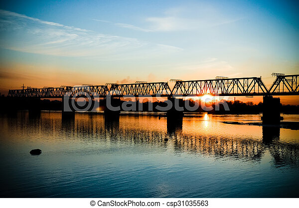 Bridge across the river at sunset - csp31035563