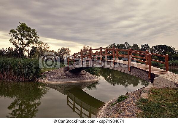Bridge in the park - csp71934074