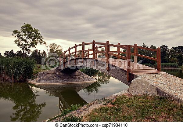 Bridge in the park - csp71934110