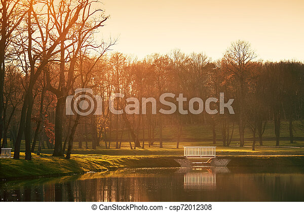 Bridge on lake autumn park - csp72012308