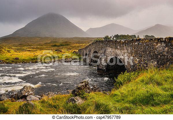 Bridge on Sligachan with Cuillins Hills in the background, Scotland - csp47957789