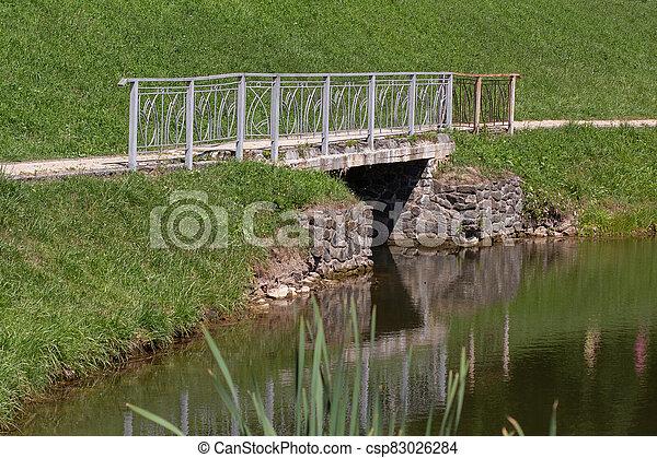 bridge on the lake in the park - csp83026284