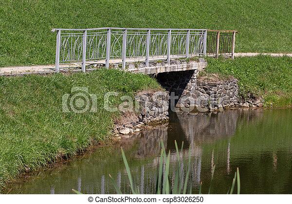 bridge on the lake in the park - csp83026250