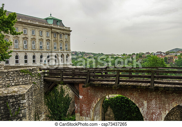 Bridge over moat in courtyard of Budapest Royal Castle. Hungary. - csp73437265