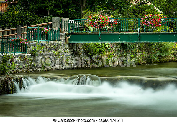 Bridge with colorful flowers in Bad Aussee - csp60474511