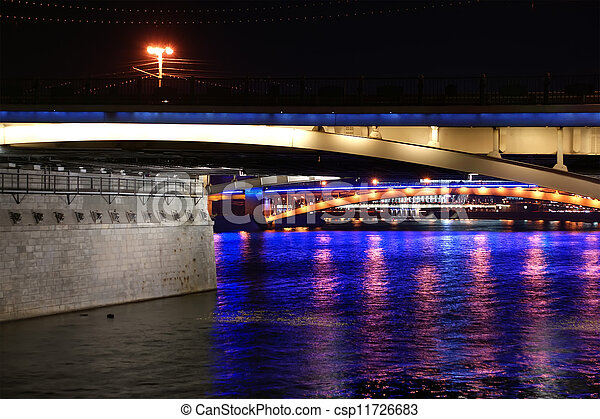 bridges on the river at night with lights reflected in water - csp11726683