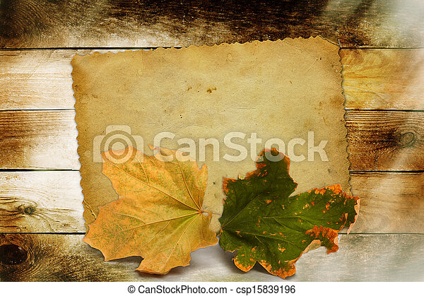 Bright autumn leaves on the wooden background  - csp15839196