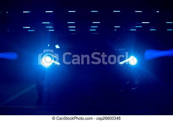 Bright Blue Car Headlights at Night - csp26600348