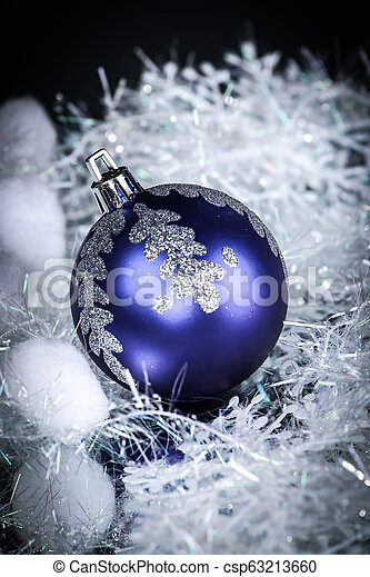 bright blue Christmas ball on a black background. - csp63213660