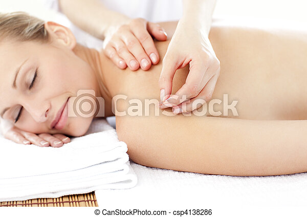 Bright caucasian woman receiving an acupuncture treatment - csp4138286