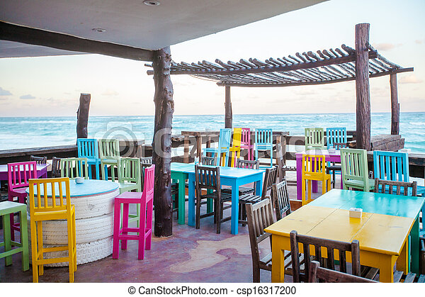 Bright colored bar-restaurant on the white sandy beach in Tulum - csp16317200