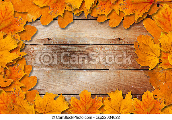 Bright fallen autumn leaves on a wooden background - csp22034622