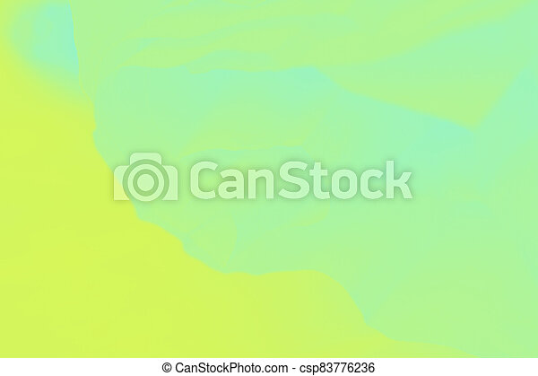 Bright green and yellow abstract blurred background - csp83776236