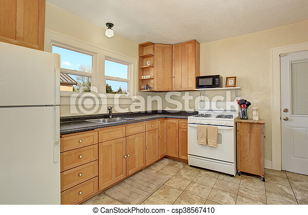 Bright Kitchen Room Interior With Honey Color Cabinets And Tile Floor White Kitchen Appliances And Black Granite Counter Top Canstock
