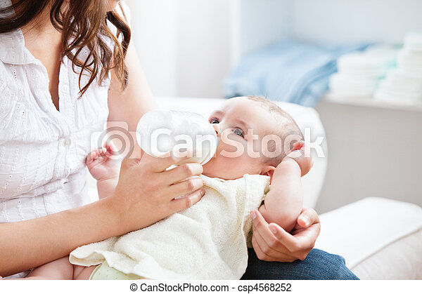 Bright mother feeding her adorable son in the kitchen - csp4568252