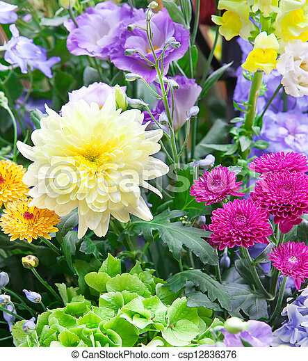 Bright multicolor bouquet made of different flowers - csp12836376