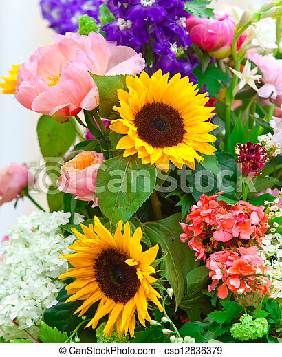 Bright multicolor bouquet made of different flowers - csp12836379