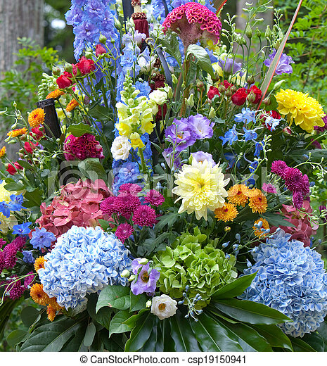 Bright multicolor bouquet made of different flowers - csp19150941
