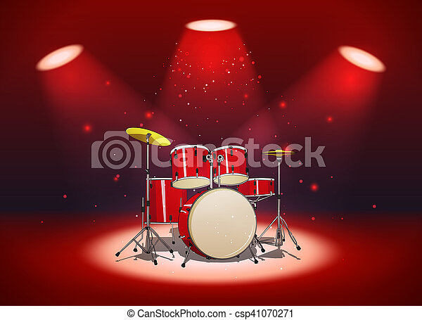 Bright red drum set in the light of spotlights - csp41070271