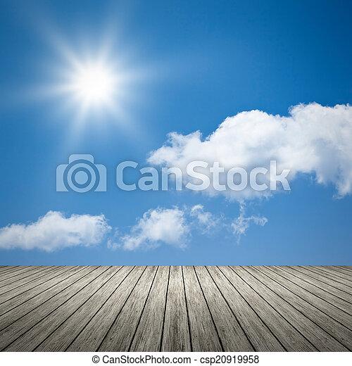 bright sun blue sky background - csp20919958