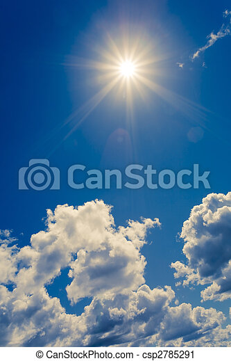 Bright sun on blue sky with clouds - csp2785291