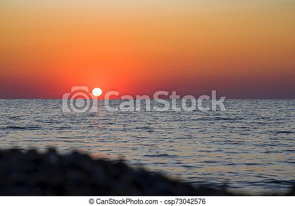 bright sunset - csp73042576