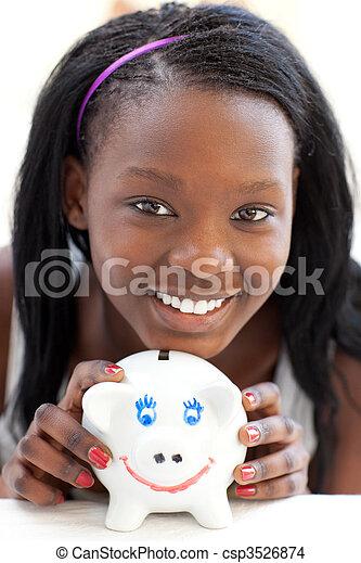 Bright teen girl holding a piggy-bank  - csp3526874