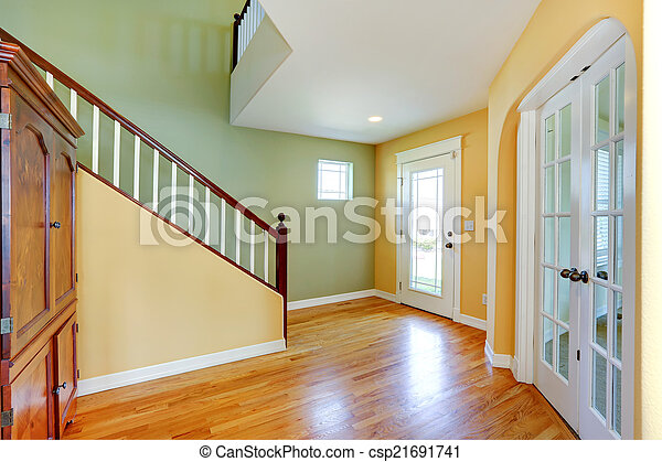 bright yellow and mint entrance hallway birght entrance hallway in