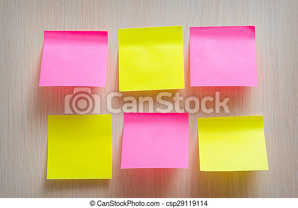 bright yellow and pink stickers on a wooden background - csp29119114