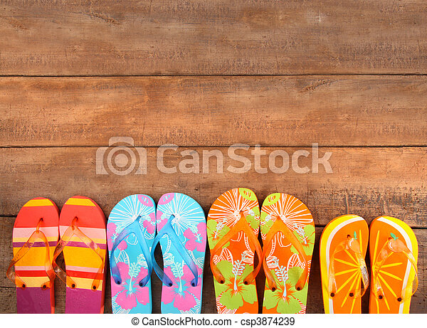 Brightly colored flip-flops on wood  - csp3874239