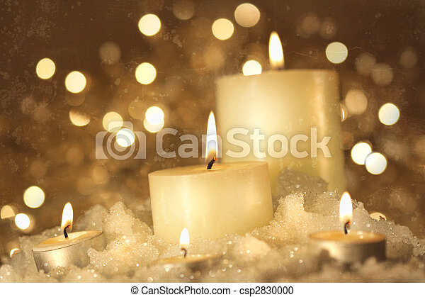 Brightly lit candles in wet snow - csp2830000