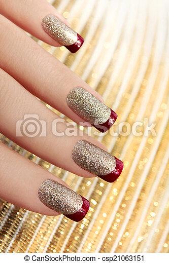 Brilliant Golden manicure. - csp21063151