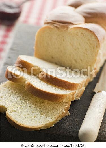 Brioche Loaf Sliced on a Chopping Board - csp1708730