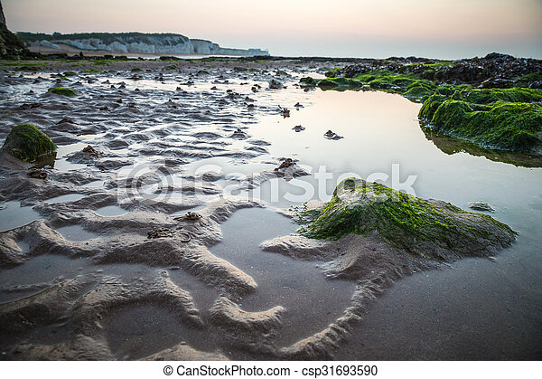 British beach at low tide sunset - csp31693590