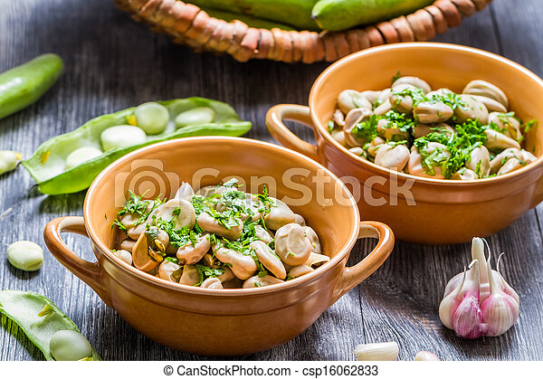 Broad beans served with parsley and garlic - csp16062833