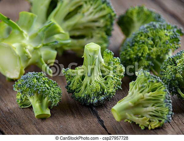 Broccoli on old wooden - csp27957728