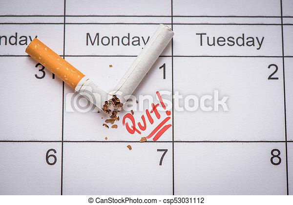 Broken cigarette on calendar. Time to quit smoking concept - csp53031112